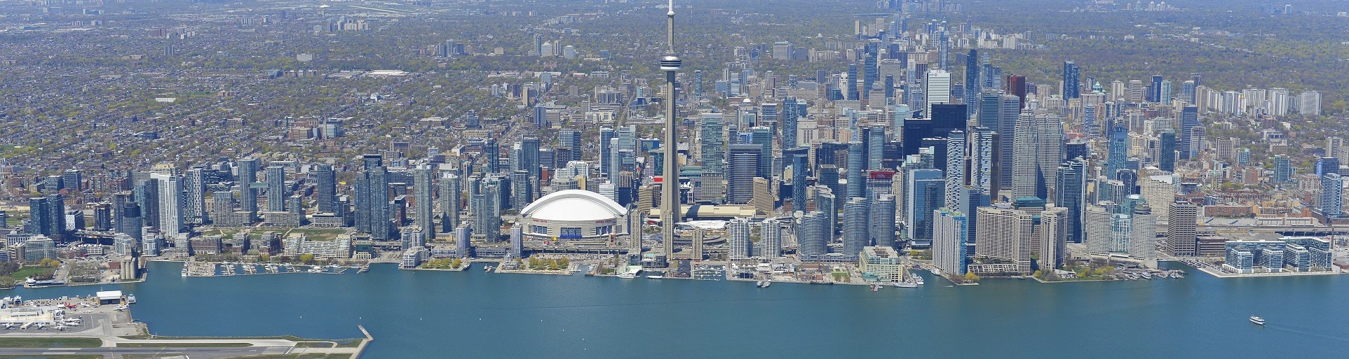 aerial photograph of Lake Ontario waterfront and Toronto skyline